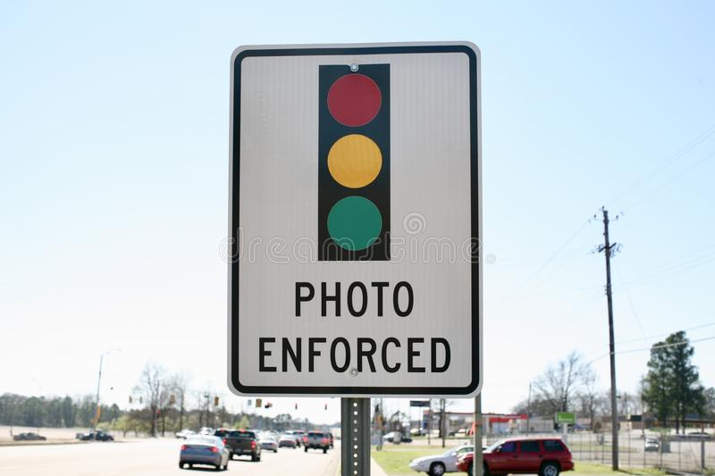 Traffic Safety Sign. A sign warns drivers that traffic safety cameras are installed at an intersection stock image