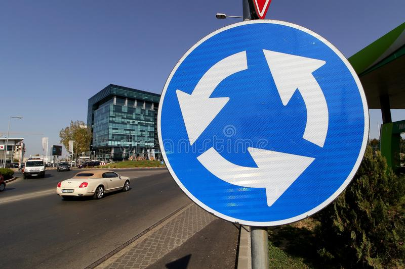 Traffic sign - Bucharest. Bucharest, Romania - October 17, 2018: A roundabout traffic sign, at an intersection in the Pipera neighborhood, in Bucharest stock photography