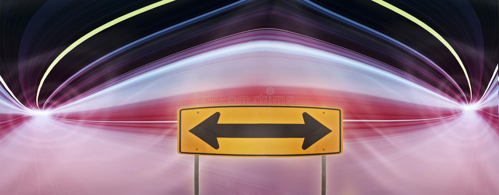 Traffic sign in a colorful highway tunnel