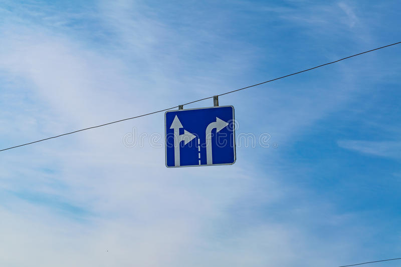 Traffic sign direction of traffic along the lanes. Traffic Signs,Traffic that is ahead of the curve,Curve signs,traffic signs on the road stock photo