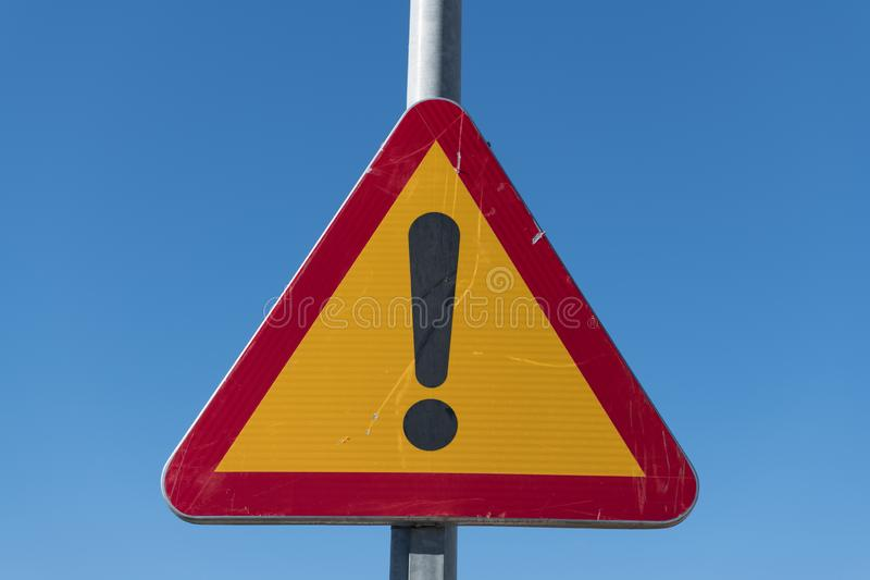 A traffic sign with an exclamation mark of an area under construction stock photos