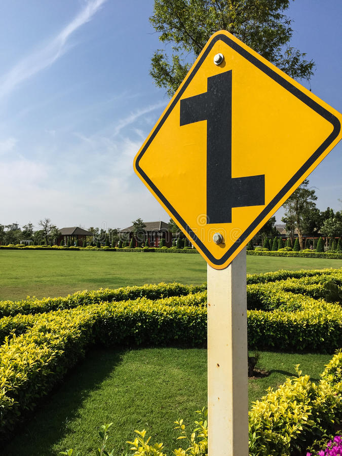 Traffic sign in the garden. Show the overhead junction royalty free stock images