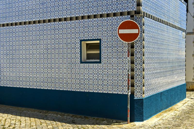 Traffic sign No entry for vehicular traffic in front of a residential building. With a fassade of decorative tiles, Santa Luzia, Algarve, Portugal royalty free stock photos