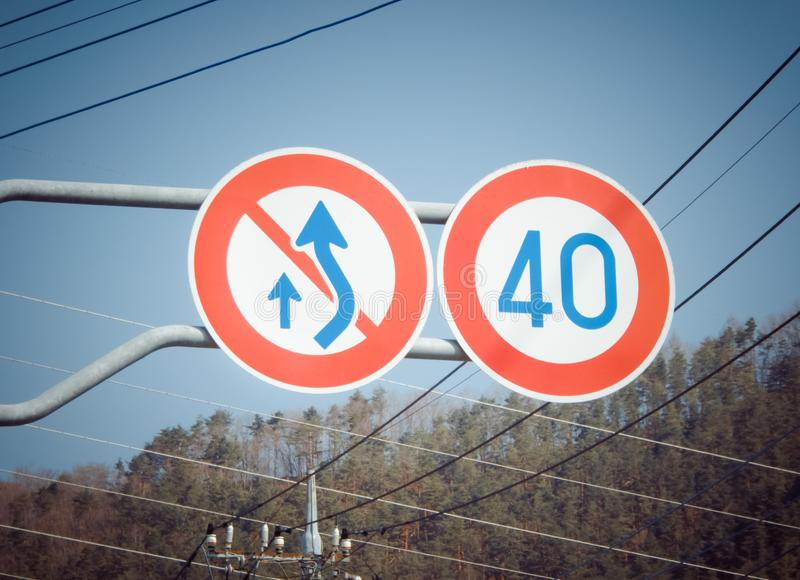 Traffic sign not overtaking and speed limit. On the highway in Japan royalty free stock photos
