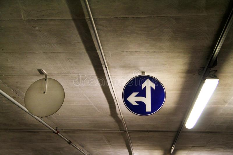 Traffic sign one way street sign in underground parking garage / Car parking bar in area in department store. royalty free stock image