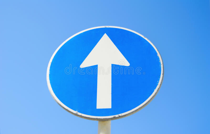 Traffic sign post go straight with blue sky background royalty free stock image