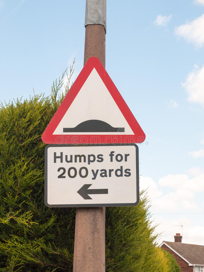 A traffic sign on a post outside humps for 200 yards direction p stock photos