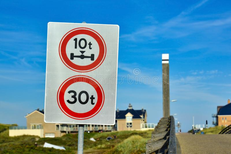 Traffic sign with sign prohibiting throroughfare of vehicles with a weight over 30t and axle weight heavier than 10t. Double traffic sign with sign prohibiting royalty free stock photos