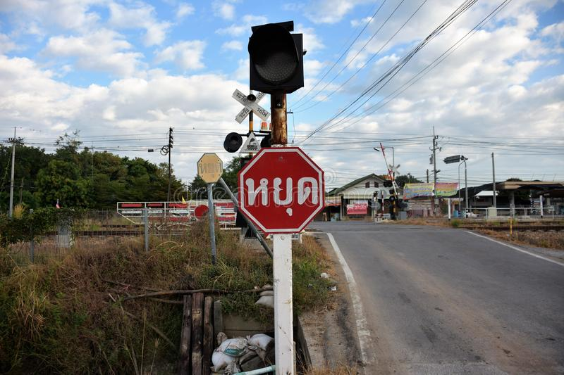 Traffic sign. Beside railroad for train, shown red sign that written stop in thai royalty free stock images