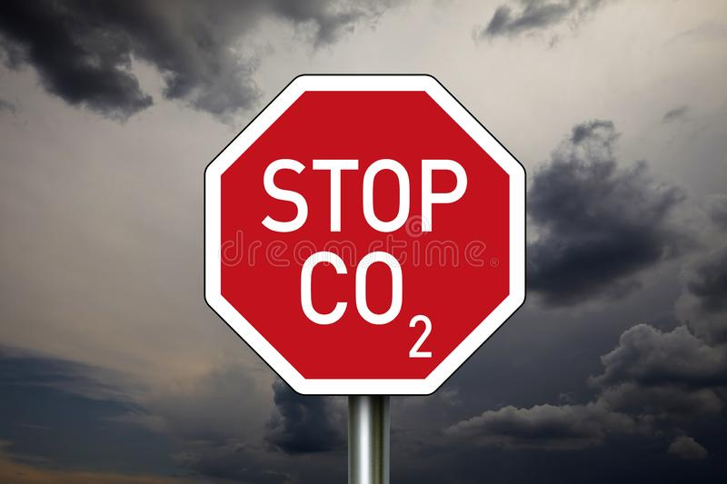 Traffic sign with STOP CO2. And dark clouds royalty free stock photo