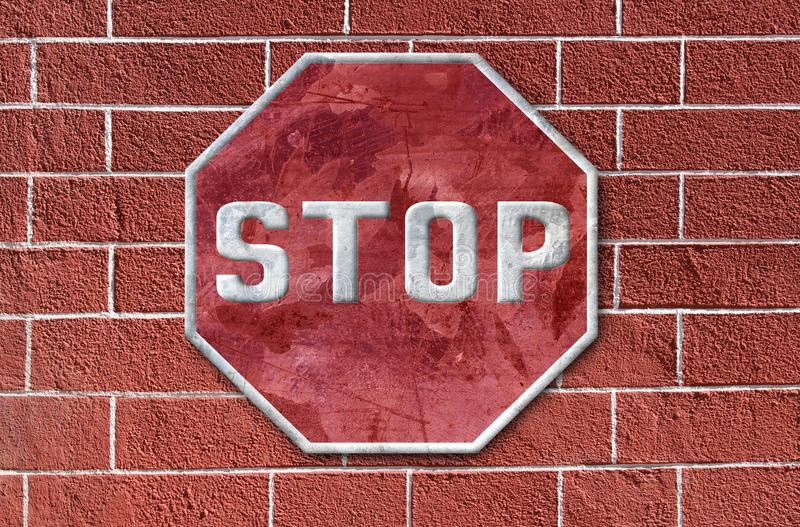 Stop on brick. Traffic sign of stop of tinplate on metal background stock photo