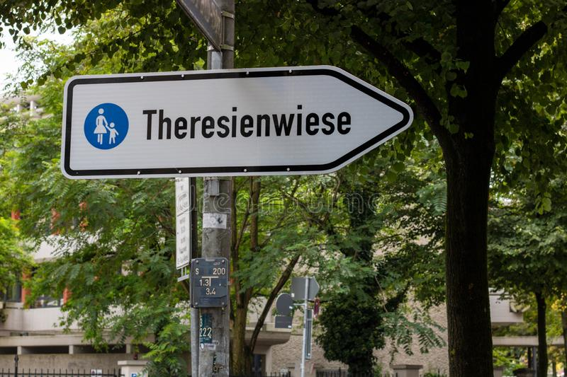 Traffic sign `Theresienwiese` place of the octoberfest pointing to the shortest way from the main station to the octoberfest in. A traffic sign `Theresienwiese` royalty free stock photos