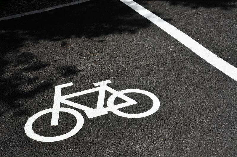 Traffic sign, white bicycle parking sign painted on asphalt floor, copy space stock images