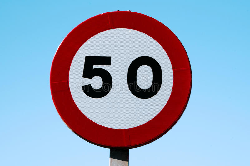 Traffic signal. Speed limit signs to 50 on blue sky royalty free stock photo