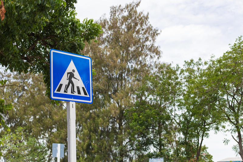 Traffic Signs Be careful crossing the street. Crossing Signs Traffic yellow board blue sky with cloud background copy space concept of road safety to reduce royalty free stock photography