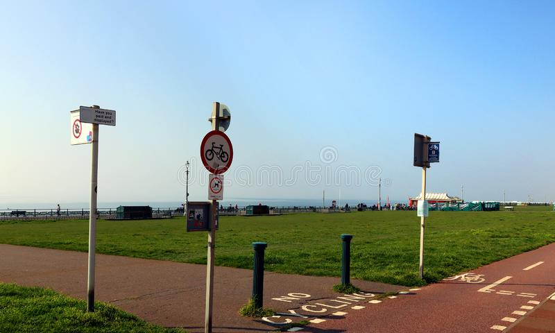 Traffic signs by bike lanes on Hove Promenade. Some of the traffic signs on the lawns on Hove Promenade in Sussex, England stock image