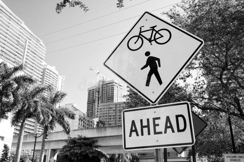 Traffic signs on city road in miami, usa. Bicycle and pedestrian crossing ahead warning. Transportation traffic and. Travel. Caution and warn concept royalty free stock photography