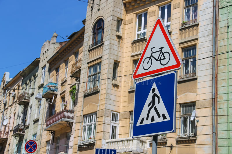 Traffic signs on the city street. (Watch for cyclists and Pedestrian crossing), Lviv, Ukraine stock photo