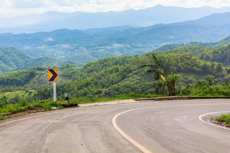 Traffic signs curve right direction on mountain highway, warning accident royalty free stock photos