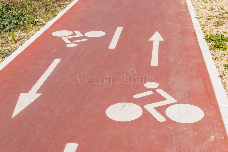 Traffic signs drawn in the Cycleway.  stock photography