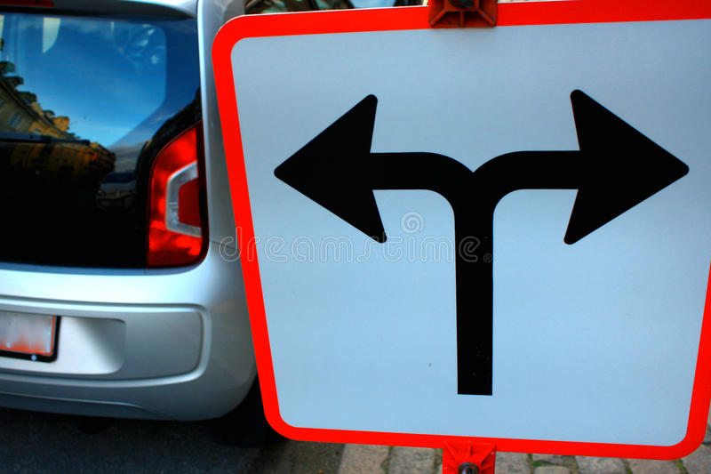 Traffic Signs in front of crossroad, Direction turn left or turn. Right royalty free stock image