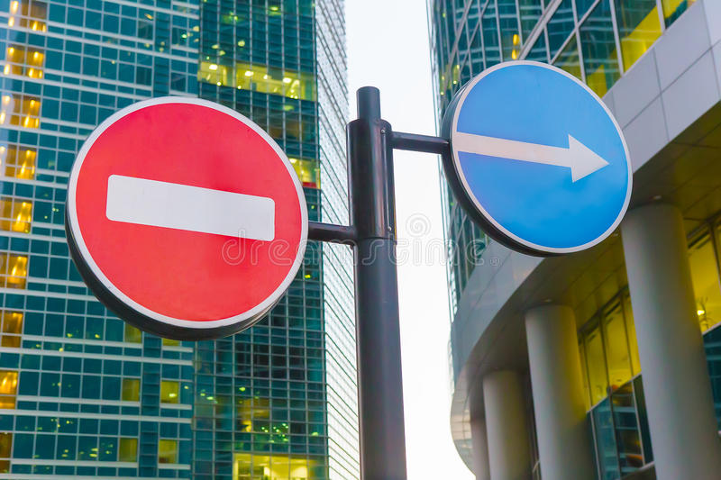 Download Traffic Signs In Front Of Skyscrapers Stock Photo - Image: 83714910