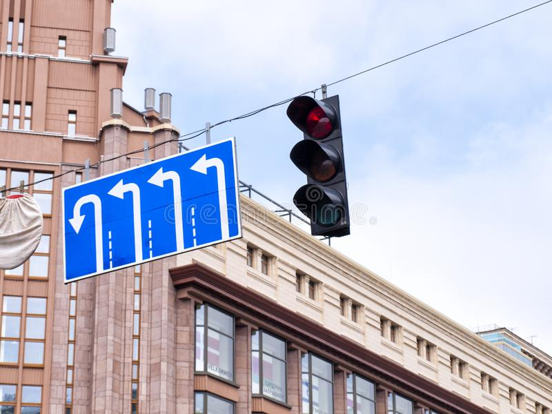 Traffic signs indicating the direction of movement and traffic light stock images