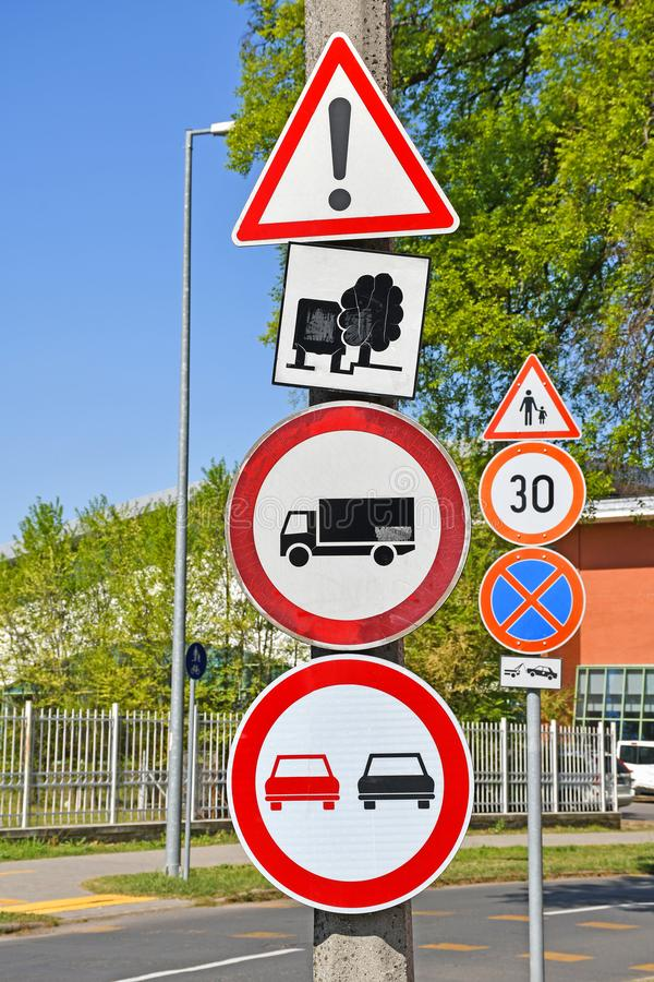 Traffic signs next to the street in the city. Outdoors royalty free stock image