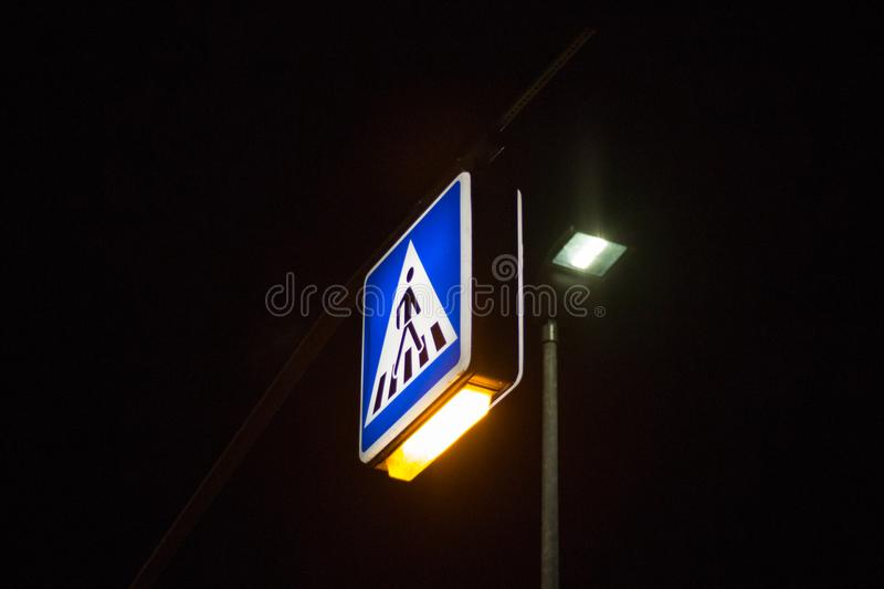 Traffic signs at night. Traffic symbols in the dark november evening in south germany near city of munich and stuttgart royalty free stock photo