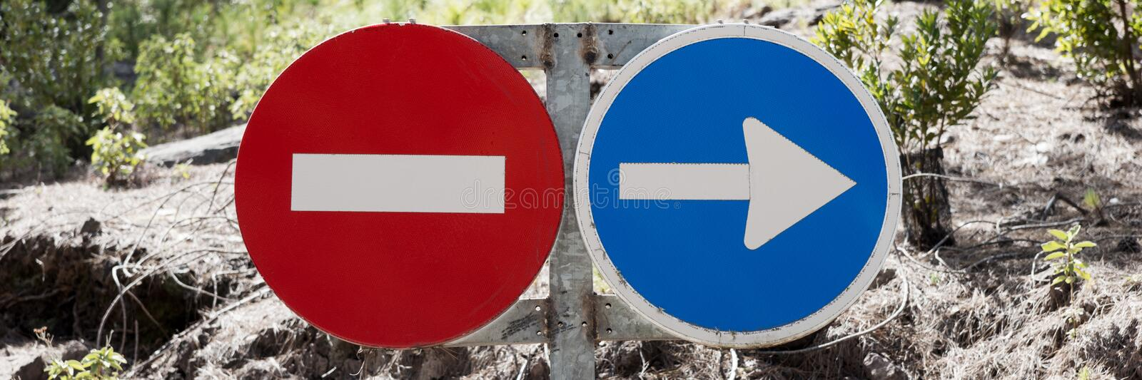 Traffic signs prohibited and driving direction. In the forest royalty free stock photography