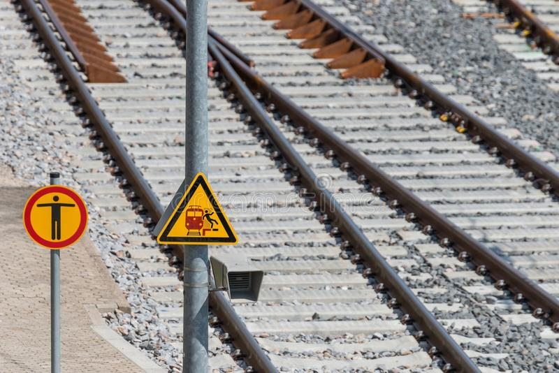 Traffic signs on the railway track: Risk of falling.  stock photography