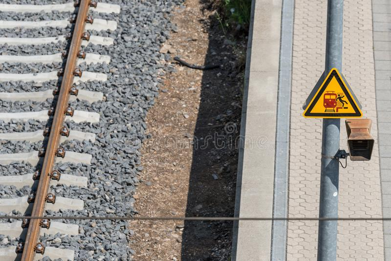 Traffic signs on the railway track: Risk of falling.  royalty free stock image