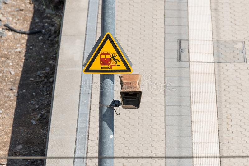 Traffic signs on the railway track: Risk of falling.  royalty free stock photography