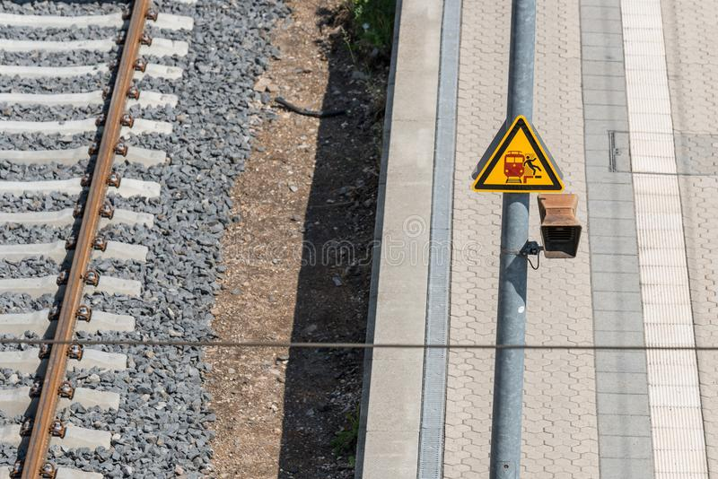 Traffic signs on the railway track: Risk of falling.  royalty free stock images