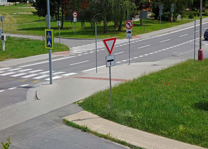 Traffic signs. Road with traffic signs, pedestrian crossing, green grass royalty free stock photo