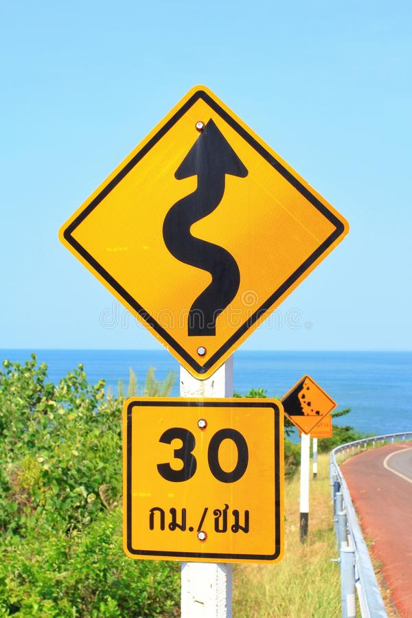 Traffic signs. Road trip seaside speed limit slow down slope royalty free stock photography