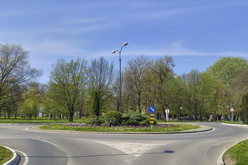 Traffic signs in roundabout junction. Roundabout junction with traffic signs in the nature stock photos