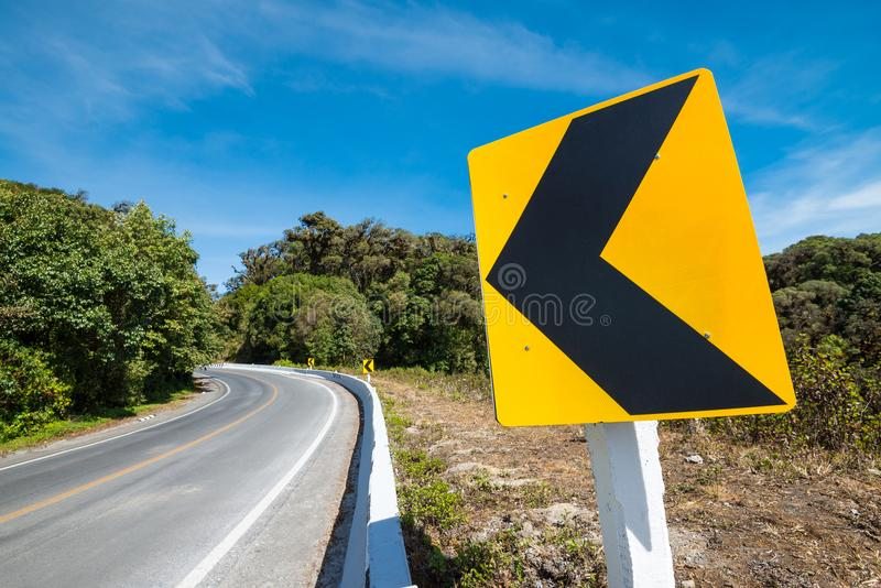Traffic signs say the curve left direction on mountain highway, stock images