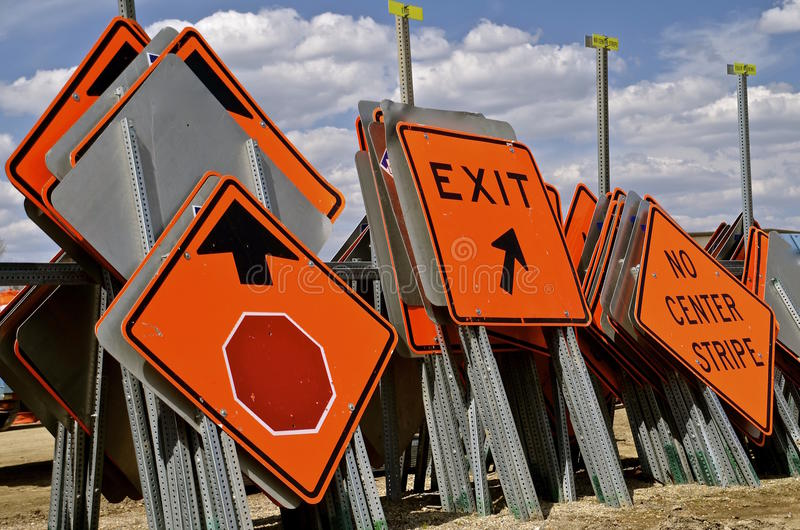 Traffic signs for speed limits. Used signs for traffic speed limits are stacked vertically in piles stock images