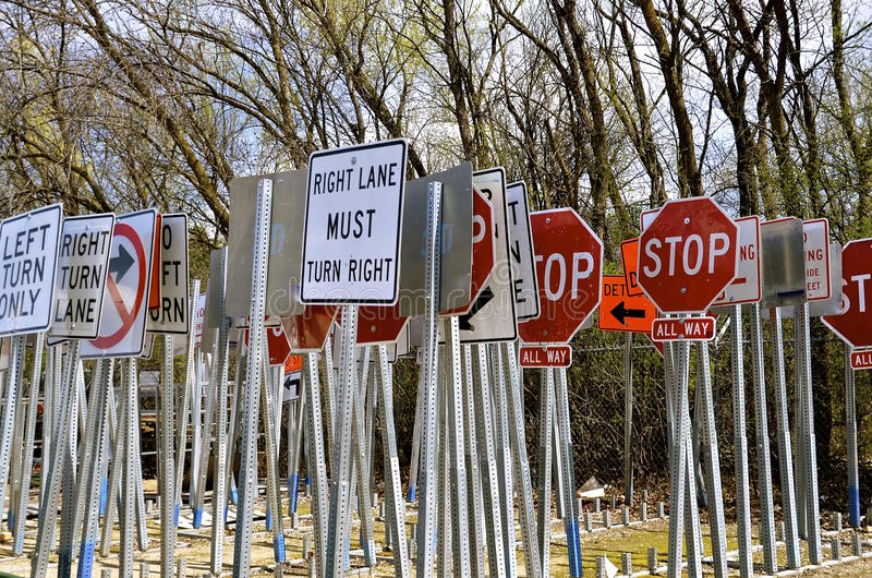 Traffic signs for speed limits. Used signs for traffic speed limits are stacked vertically in piles royalty free stock photo