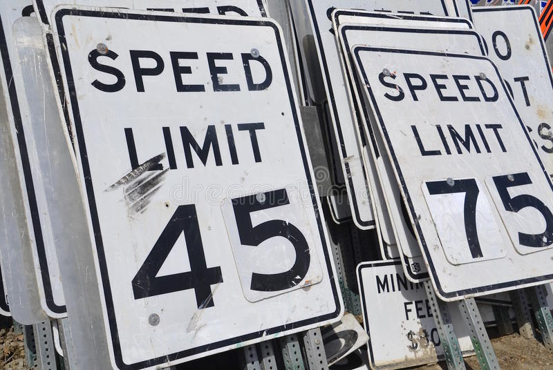 Traffic signs for speed limits. Used signs for traffic speed limits are stacked vertically in piles royalty free stock photography