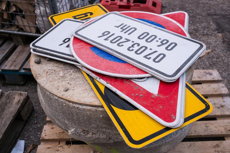 Traffic signs on a stone at a roadwork. Several traffic signs on a stone at a roadwork royalty free stock photo
