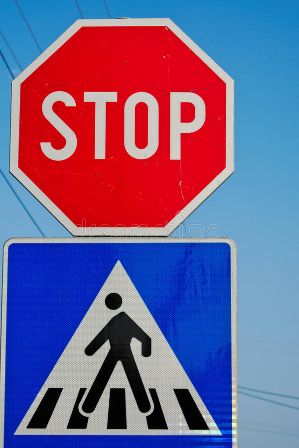 Traffic Signs. Stop and crosswalk traffic signs royalty free stock photography