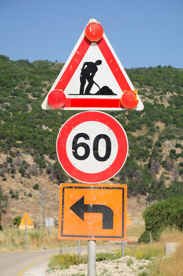 Traffic signs. Three traffic signs and тче green hill at the background. Northern Israel royalty free stock photo