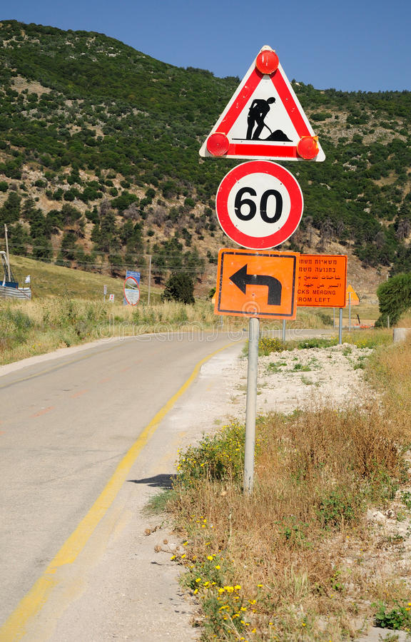 Traffic signs. Three traffic signs and тче green hill at the background. Northern Israel stock image
