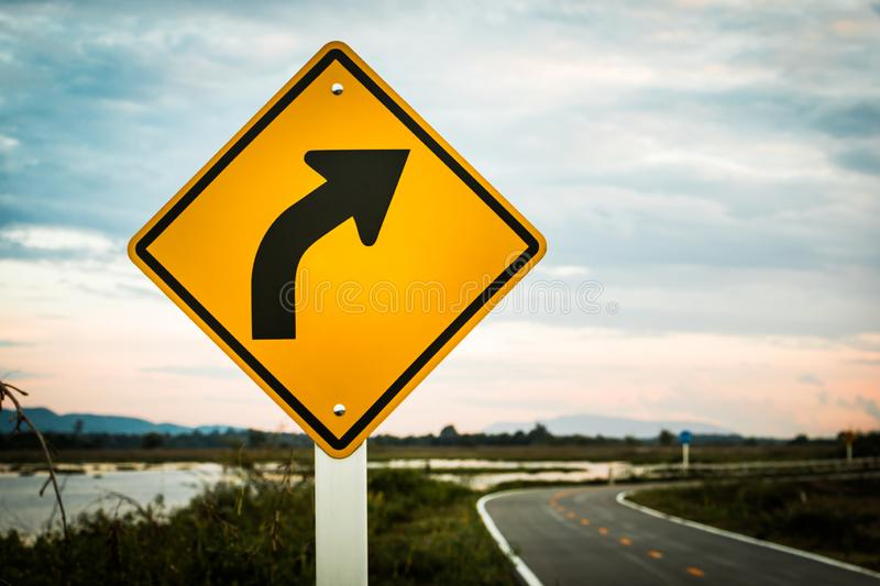 Traffic signs turn right into the sky and the river stock image