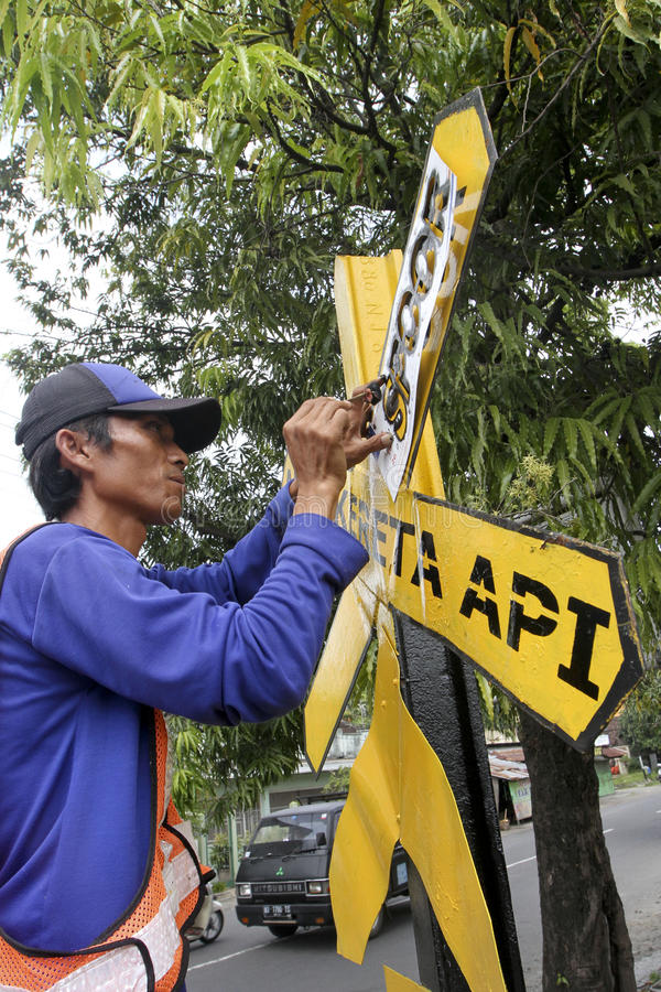 Traffic signs. Workers were fixing the damaged traffic signs in the city of Solo, Central Java, Indonesia stock photo