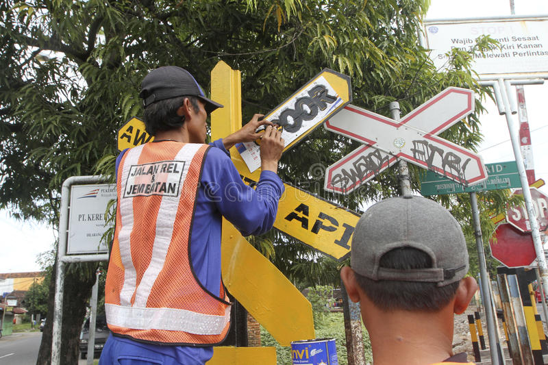 Traffic signs. Workers were fixing the damaged traffic signs in the city of Solo, Central Java, Indonesia royalty free stock images