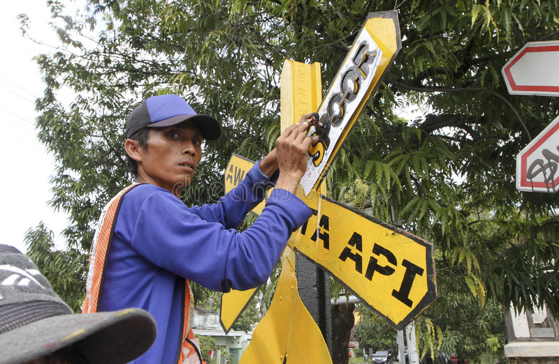 Traffic signs. Workers were fixing the damaged traffic signs in the city of Solo, Central Java, Indonesia royalty free stock photos