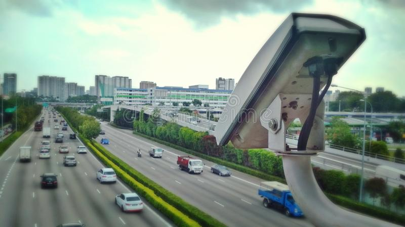 Traffic speed video camera. Video cam mounted on pedestrian overhead bridge to monitor traffic speed along Central Expressway in Singapore royalty free stock photography